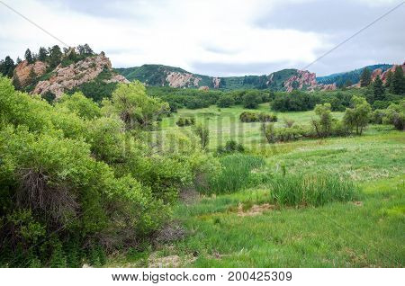 meadow and red sandstone rock formations at roxborough state park in douglas county colorado