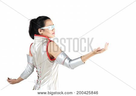 Young woman wearing futuristic glasses while holding something isolated on white background