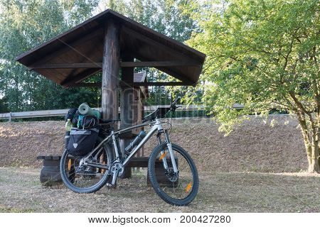 Mountain Bike With Saddlebags Round The Wooden Arbour