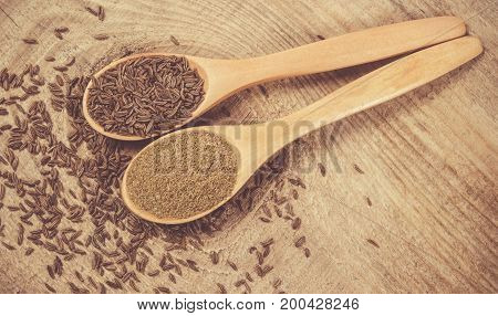 Ground Cumin In A Spoon And Whole Cumin
