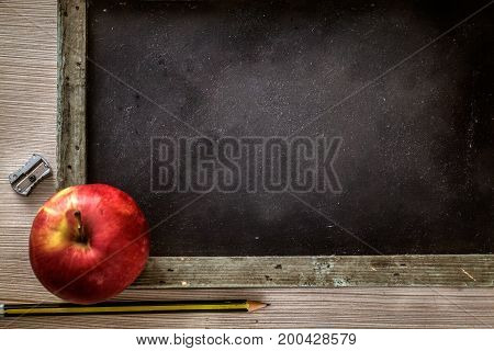 School objects for students. Chalkboard pencils crayons and apple
