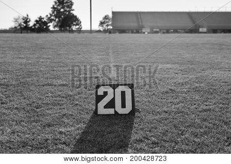 the twenty yard line marker and the twenty yard line in black and white