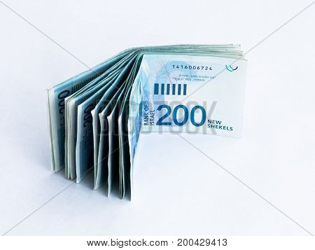 Several New Banknotes Worth 200 Israeli New Shekels On A White  Background