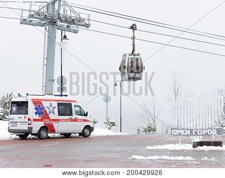 Sochi - March 28 2017: An ambulance car in the mountains and a ski lift March 28 2017 Sochi Russia