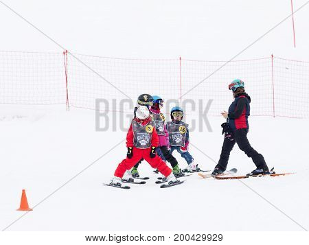 Sochi - March 28 2017: Children in mountain skiing learn to ski with a coach in the mountains March 28 2017 Sochi Russia