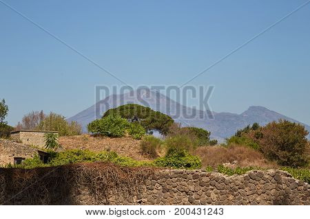 Pompeian landscape on a summer sunny day with Vesuvius in the background