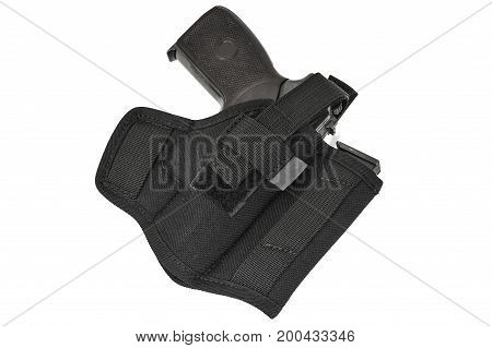 The gun in the holster. Isolated background