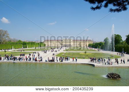 VIENNA, AUSTRIA - APR 30th, 2017: Schonbrunn Palace with Neptune Fountain in Vienna. It's a former imperial 1441-room Rococo summer residence of Sissi Empress Elisabeth of Austria in modern Wien Schoenbrunn.
