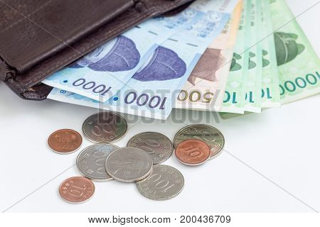 Different value South korean currency near the wallet save your money concept