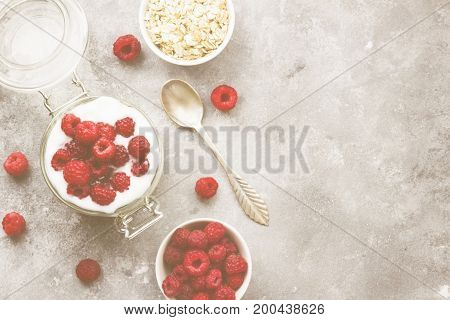 Glanola In Glass Jar With Raspberry And Mint On A Gray Background. Top View, Copy Space. Food Backgr