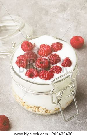 Glanola In Glass Jar With Raspberry And Mint On A Gray Background. Toning