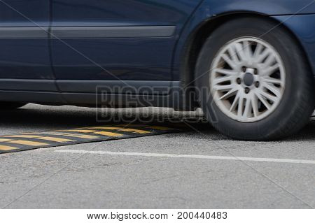 car driving through a speed bump close-up