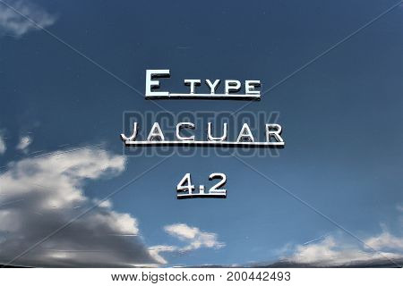 An image of a jaguar e-type logo with clouds - Hameln/Germany - 08/20/2017