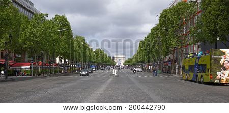ParisFrance- April 30 2017: Champs Elysees. Pedestrians and vehicles are moving