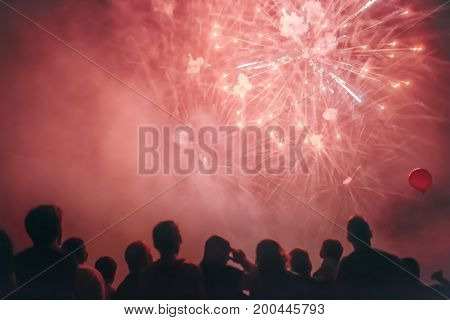 Crowd watching fireworks and celebrating new years eve