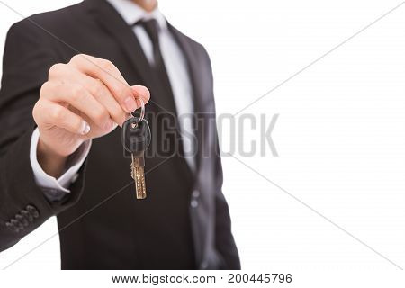 Unrecognizable businessman offering key to house, car or business, motivation poster, copy space, isolated on white
