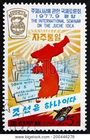 NORTH KOREA - CIRCA 1977: a stamp printed in North Korea shows Map of Korea Anti-American texts circa 1977