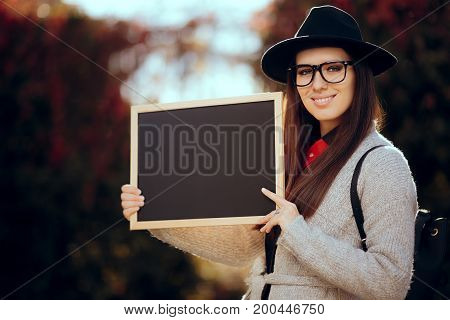 Happy Student Holding a Blackboard Sign Sale Announcement