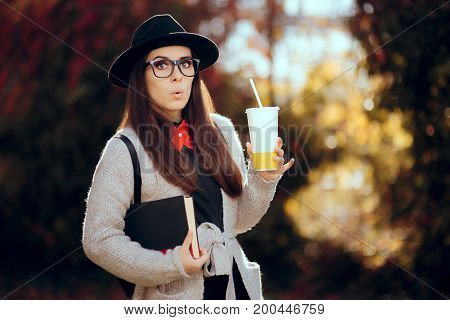 Surprised Female Student Holding a Hot Drink and a Book