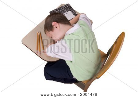Boy Sleeping At School Desk