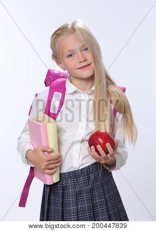 Portrait of cute schoolgirl on white