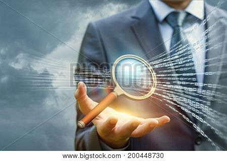 Businessman With A Magnifying Glass Searches In The Sky Information.