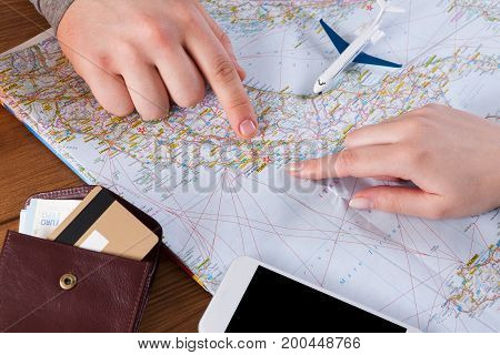 Couple planning trip to Rome, Italy, pointing on this city on map. Travel background with accessories
