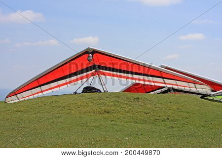 Hang Gliders prepared to fly on a hill