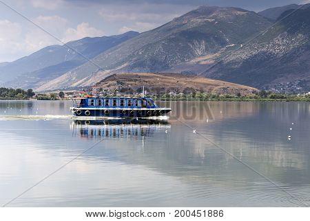 View of the lake Pamvotis and swimming ship (Epirus region, Greece)