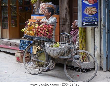Kathmandu, Nepal, september 4, 2015: Rush in streets of Thamel, the tourist place in Kathmandu, Traders with bicycle sells the fruit