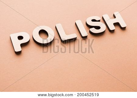 Word Polish on beige background. Foreign language learning, education concept