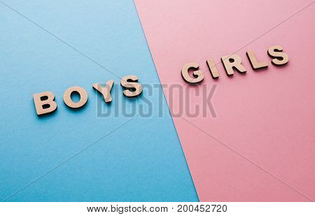 Words Boys and Girls on bright backgrounds. Unknown baby gender, uncertainty and doubt concept