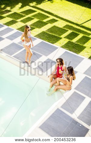 Young Woman Having Fun By The Pool