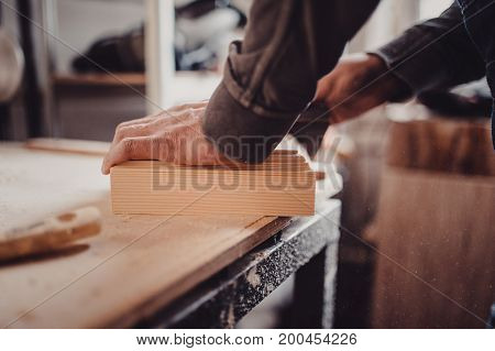 Man Sanding Wooden Panel. Process Of Manual Sanding Of A Furniture Part