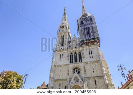 ZAGREB, CROATIA - JULY 17, 2017: Zagreb cathedral, one of the towers of the cathedral is tightened with awning during the restoration.