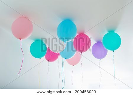 the beautiful balloons on white wooden background