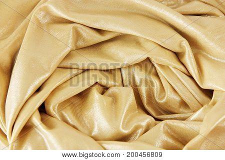 Golden fabric soft silk texture as background