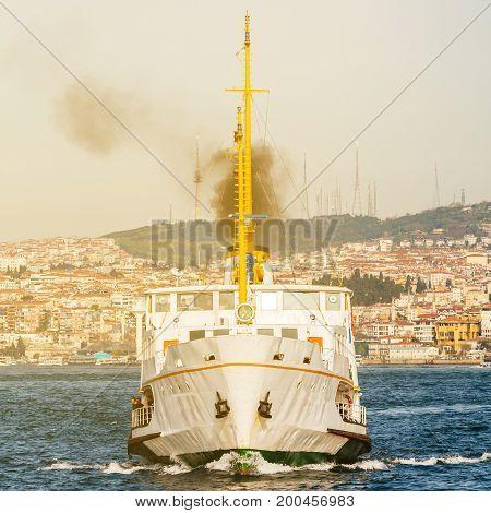 Ship for transportation of passengers on city background. Istanbul. Travel Turkey. Ship for the transportation of goods. Bosphorus.