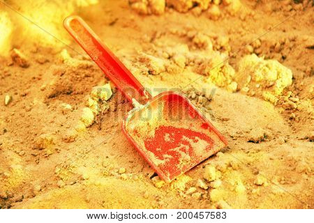 Golden Shining Sand And Plastic Sovochke. Symbol Of Gold Mining. The Gold-bearing Rock. Also A Symbo