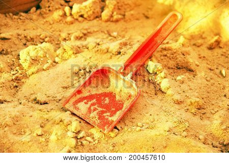 Golden Shining Sand And Plastic Scoop. Symbol Of Gold Mining. The Gold-bearing Rock. Also A Symbol O