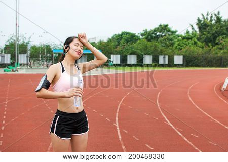 Tired Female Jogger At The Running Track