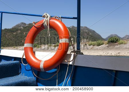 Lifebuoy on board a boat against the backdrop of mountains