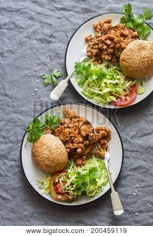 Minced pork burgers with salad on a gray background top view. Delicious snack