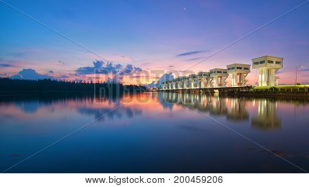 The bright sky a beautiful blue color at Uthokawiphatprasit Watergate, Pak Phanang, Nakhon Si Thammarat Diversion Dam Project is a project specifically approved by His Majesty the King of Thailand