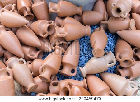 Small toy copies of ancient greek amphoras