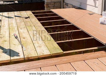 Repair and replacement of an old wooden deck or patio with modern composite plastic material