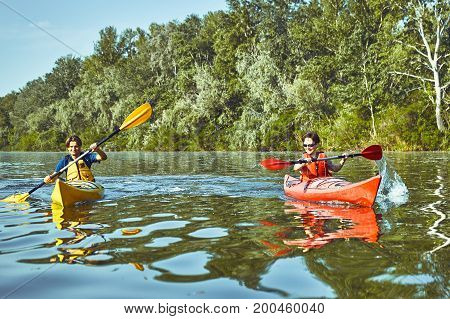 Summer trip on the river on kayaks on a sunny day.