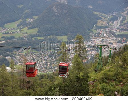 Two Red Ski Gondol Lift Carrier with Mountain Valley Background