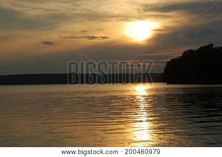 gorgeous rustic sunset over lake auburn in summer