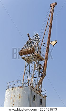 Detail from a Floating Crane on a background sky